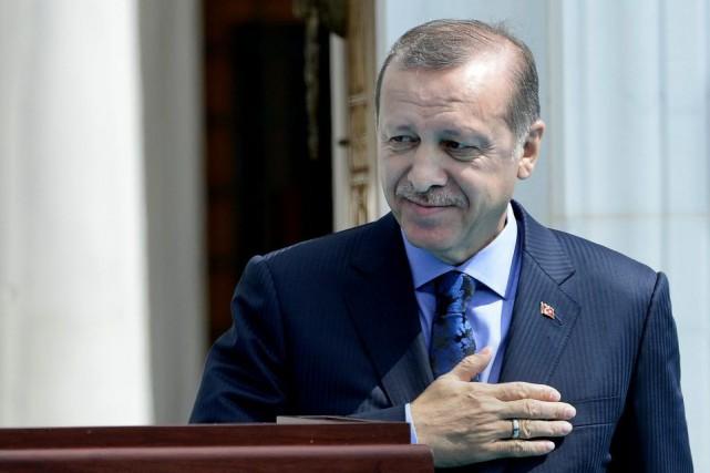 Le président turc Recep Tayyip Erdogan en visite... (PHOTO OLIVIER DOULIERY, AFP)