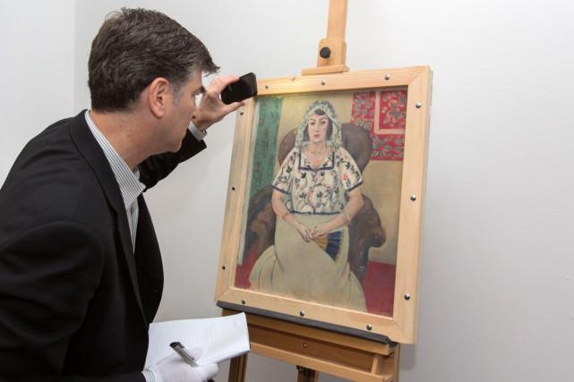 Le tableau Femme assise d'Henri Matisse fait partie... (PHOTO ARCHIVES AFP)