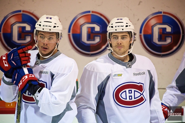 C'est au tour de Ryan Johnston (à droite)... (André Pichette, archives La Presse)
