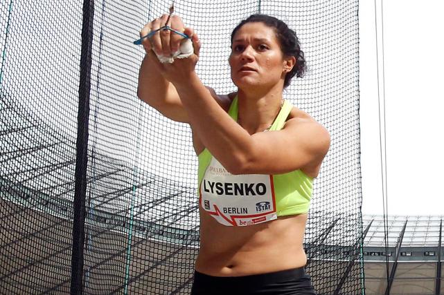 La championne olympique du lancer du marteau en... (Photo Michael Sohn, archives AP)