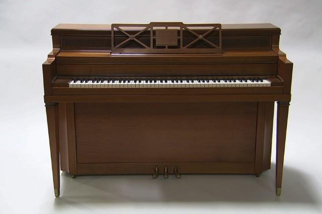Le premier piano de Lady Gaga fait partie... (PHOTO AP)