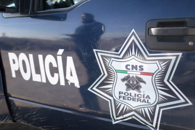 Quatre hommes armés circulant à bord d'un faux véhicule de police ont été... (Photo Pedro Pardo, archives AFP)