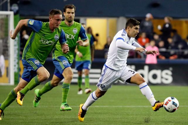 Lucas Ontivero (à droite) lors du match de... (photoTed S. Warren, associated press)