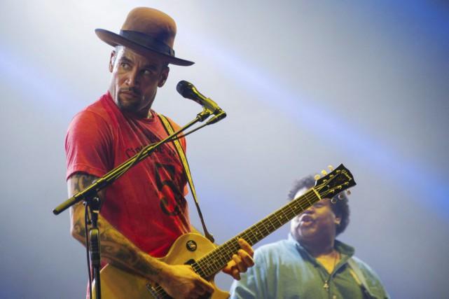 Ben Harper s'estentouré de son groupe original les... (AFP, Sébastien Bozon)