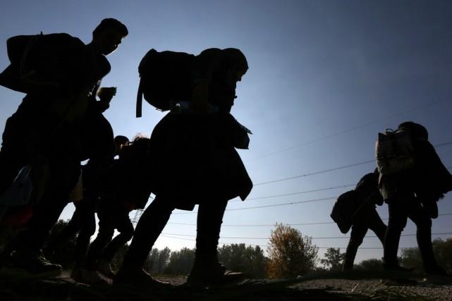 Kim Thúy et Dimitri Nasrallah étaient enfants quand ils ont dû respectivement... (Archives AFP)
