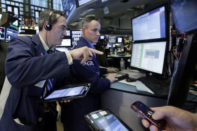 Wall Street semblait surtout cultiver la prudence, car... (Photo Richard Drew, AP)