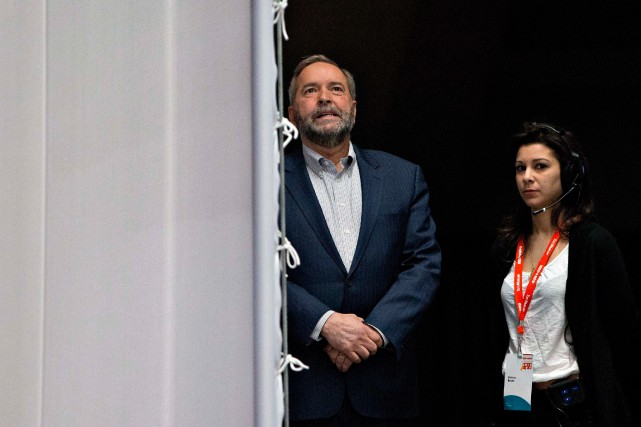 Federal NDP Leader Tom Mulcair waits to go...