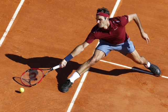 Roger Federera vaincu Guillermo Garcia-Lopez 6-3, 6-4, mardi,... (Photo Valery Hache, AFP)