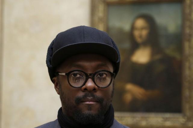 Will.I.Ams'est laissé filmer et photographier devant le tableau... (PHOTO AFP)