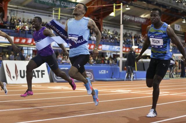 Le sprinteur canadien Andre De Grasse (au centre),... (AP, Julie Jacobson)