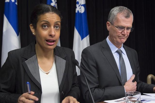 La ministre du Développement économique, DominiqueAnglade, et le... (PHOTO JACQUES BOISSINOT, LA PRESSE CANADIENNE)
