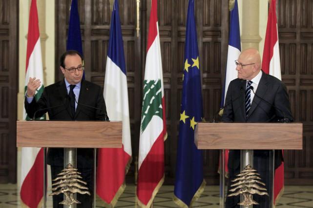 Le président françaisFrançois Hollande aux côtés du premier... (Photo Bilal Hussein, AP)