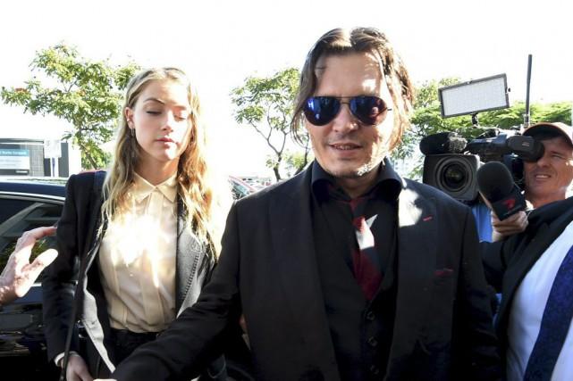 Amber Heard et Johnny Depp à leur arrivée... (PHOTO REUTERS)