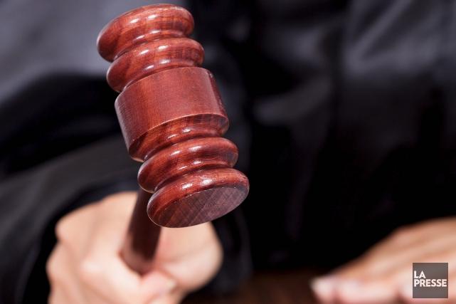 Le Barreau conteste la constitutionnalité de l'imposition de... (123rf/Andriy Popov)