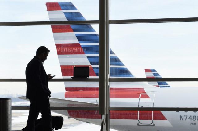 Le groupe américain de transport aérien American Airlines, profitant notamment... (PHOTO SUSAN WALSH, ARCHIVES AP)