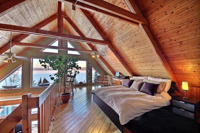 Une splendide maison en bois, sise dans un site enchanteur en bordure du... (Via Capitale)