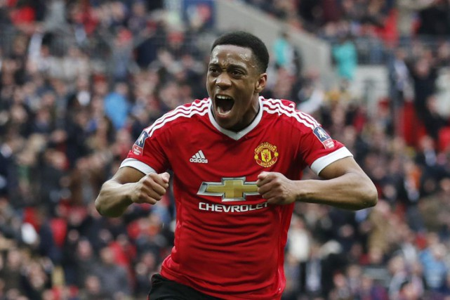 Anthony Martial a procuré la victoire aux Red... (PHOTO EDDIE KEOGH, REUTERS)