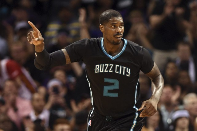 Marvin Williams célèbre son panier.... (PHOTO SAM SHARPE, USA TODAY)