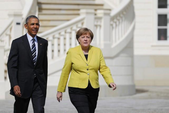 Barack Obama et Angela Merkelà Hanovre, dans leNord... (PHOTO KAI PFAFFENBACH, REUTERS)
