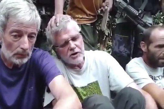 La victime est le Canadien John Ridsdel(au centre).... (La Presse Canadienne)