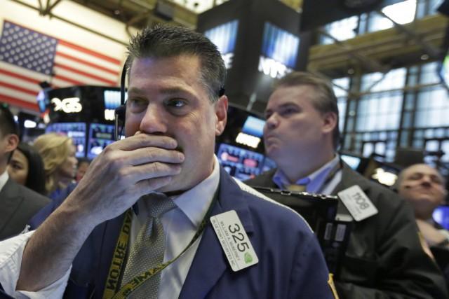 Selon des résultats définitifs, l'indice vedette Dow Jones... (Photo Richard Drew, AP)