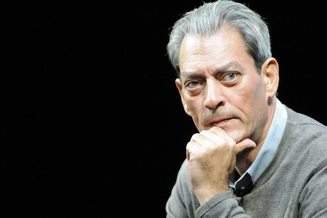 L'auteur Paul Auster n'avait pas publié de fiction... (PHOTO ARCHIVES AFP)