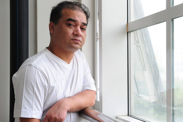 Ilham Tohti, 47 ans, est un universitaire «modéré»... (PHOTO FREDERIC J. BROWN, ARCHIVES AFP)