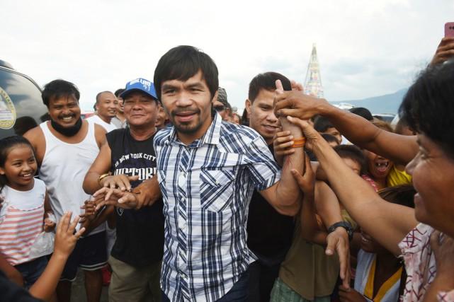 Les sondages montrent qu'Emmanuel «Manny» Pacquiao est quasiment... (PHOTO TED ALJIBE, AFP)