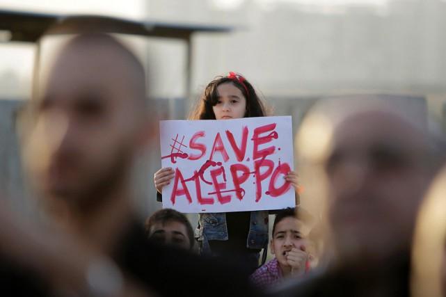 Face à la tragédie à Alep, le hashtag... (PHOTO IBRAHIM CHALHOUB, AFP)