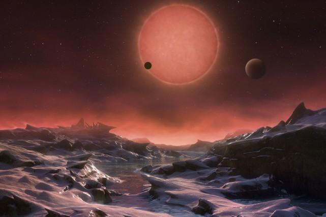 Trois exoplanètes «potentiellement habitables» ont été découvertes en orbite... (AP)