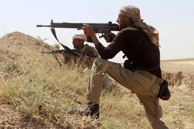 Les forces fédérales irakiennes et kurdes, soutenues par... (PHOTO AFP)