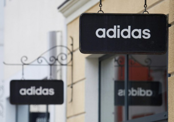 Boards with Adidas store logo are seen on... (PHOTOGRIGORY DUKOR, REUTERS)