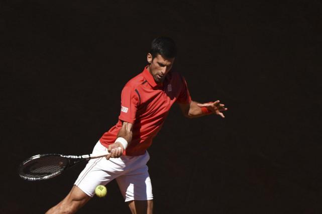 Le Serbe Novak Djokovic a facilement obtenu son... (Pedro Armestre, AFP)