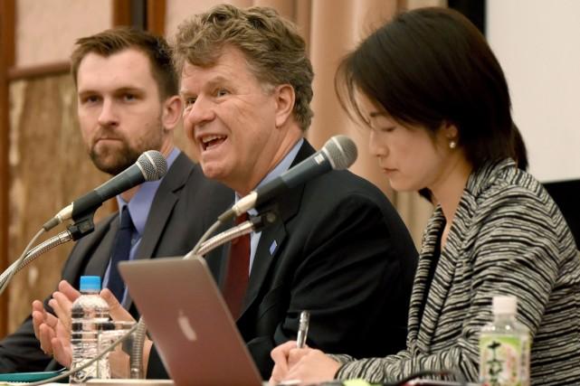De gauche à droite: Kyle Knight, Boris Dittrich... (PHOTO TORU YAMANAKA, AFP)
