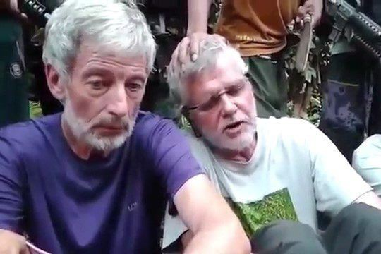 Robert Hall (à gauche) et John Ridsdel ont... (Tirée d'une vidéo YouTube)