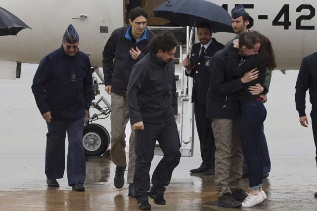 Angel Sastre,José Manuel Lopez etAntonio Pampliega à leurdescente... (AFP)