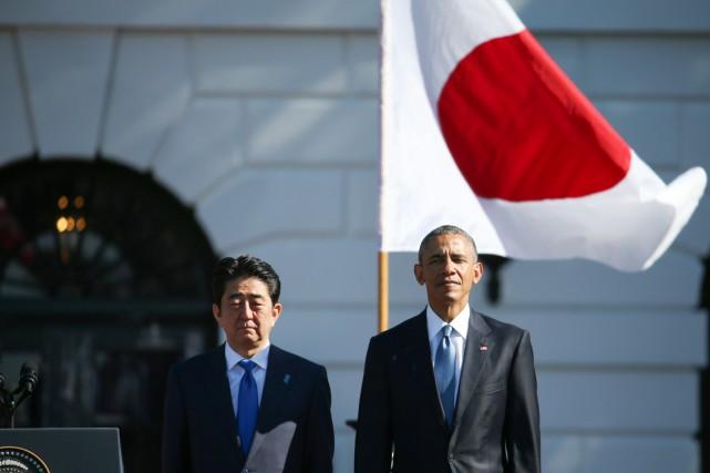 Le président américain Barack Obama et le premier... (PHOTO ANDREW HARNIK, ARCHIVES AP)