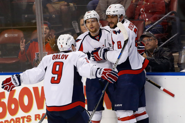Dmitry Orlov, Evgeny Kuznetsov et Alexander Ovechkin... (Photo Robert Mayer, USA Today)