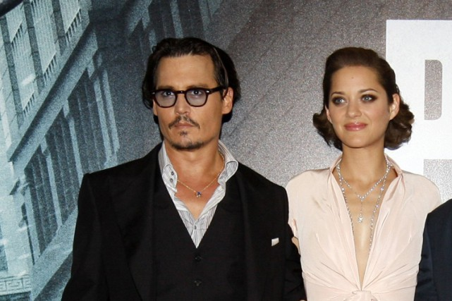 Johnny Depp et Marion Cotillard lors de la... (ARCHIVES REUTERS)