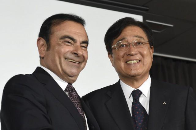 Le président de Nissan Carlos Ghosn et le... (TOSHIFUMI KITAMURA)