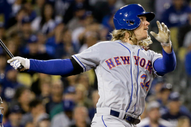 Le lanceur des Mets de New YorkNoah Syndergaard... (AP, Chris Carlson)