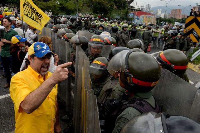 L'opposition a manifesté à plusieurs reprises ces dernières... (PHOTO JUAN BARRETO, AFP)
