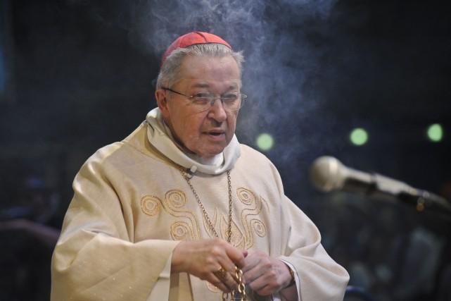 L'archevêque de Paris, le cardinal André Vingt-Trois... (PHOTO XAVIER LEOTY, AFP)