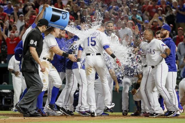 Drew Stubbs a donné la victoire aux Rangers... (Photo Tony Gutierrez, Associated Press)