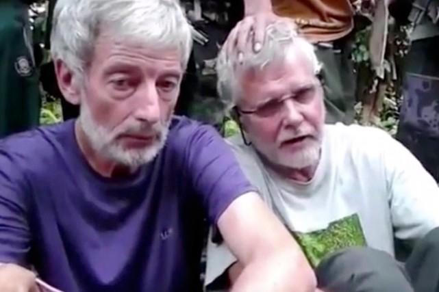 Les Canadiens Robert Hall et John Ridsdel, enlevés... (Tirée d'une vidéo militante via AP)