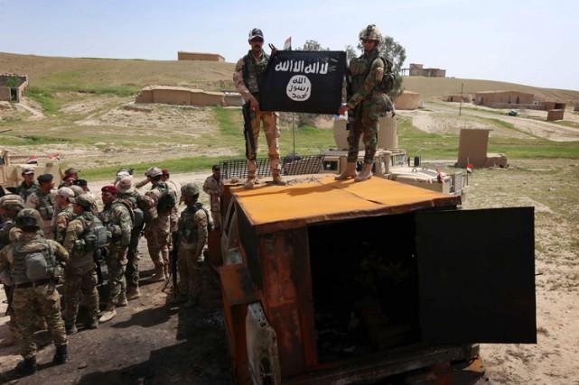 Le groupe État islamique a perdu près de la moitié du territoire qu'il avait... (PHOTO AFP)
