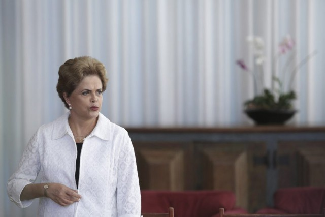 Dilma Rousseff profite de la tribune virtuelle pour défendre... (Photo Eraldo Peres, archives AP)
