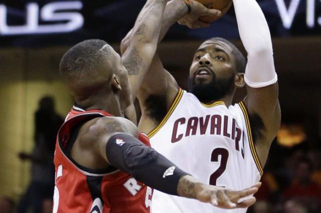 Kyrie Irving a inscrit 26 points pour les... (Tony Dejak, AP)