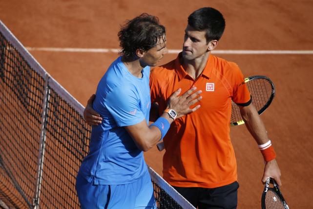 Rafael Nadal et Novak Djokovic... (Photo Kenzo Tribouillard, archives AFP)