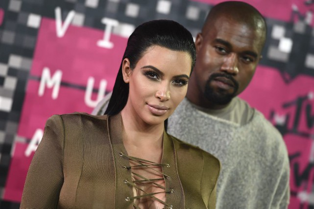 Kim Kardashian et Kanye West... (Photo Jordan Strauss, archives AP)
